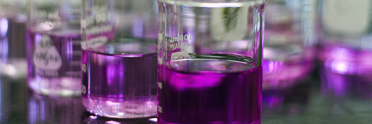 Permanganate value test results, purple liquid in large clear vial